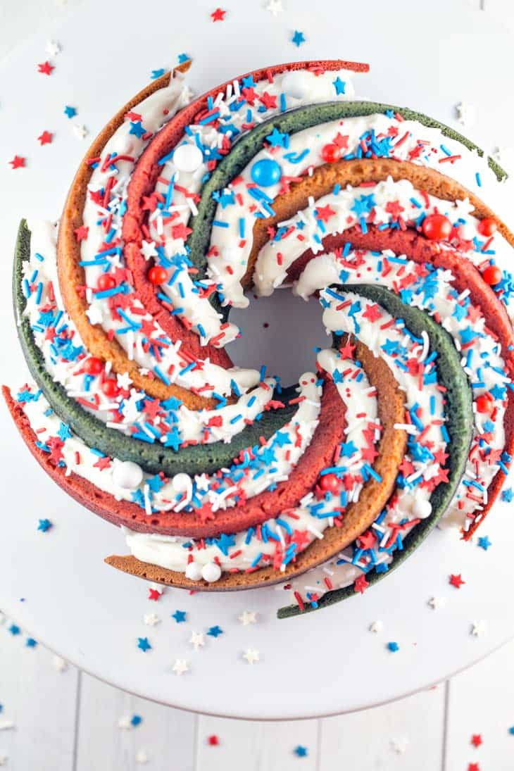 Red White and Blue Bundt Cake: This star-spangled patriotic spiral bundt cake will be the talk of your 4th of July Party! Decadent buttery vanilla cake in a perfectly colored spiral . USA! USA! {Bunsen Burner Bakery}