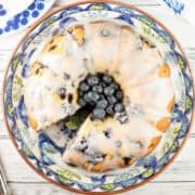Lemon Blueberry Bundt Cake: the perfect vanilla pound cake, bursting with fresh blueberries and lemon zest, topped with a sweet lemon glaze. It's the perfect year-round treat! {Bunsen Burner Bakery}