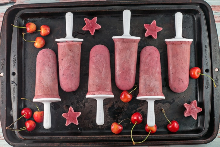 Watermelon Cherry Popsicles: only 4 ingredients and 5 minutes necessary for creamy, fruity popsicles made from pureed fresh fruit and yogurt. The perfect refreshing summer dessert! {Bunsen Burner Bakery}