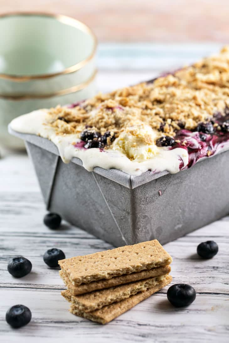 Blueberry Pie Ice Cream: it's your favorite summer pie... in ice cream form! A creamy vanilla ice cream paired with homemade blueberry pie filling and graham cracker crumbs, it's the ultimate summer treat. Pie + ice cream = perfection! {Bunsen Burner Bakery}