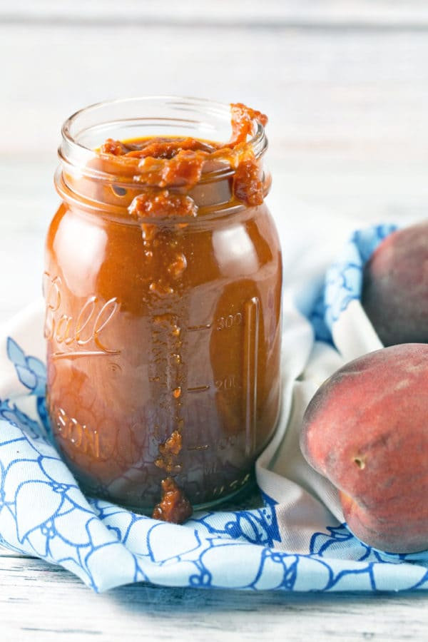 Spicy Whisk Peach BBQ Sauce: Stock up on fresh peaches to make this easy, homemade Whiskey Peach BBQ Sauce, perfect for grilling. Delicious on pork, chicken, steak, salmon, and everything else you can grill! {Bunsen Burner Bakery}