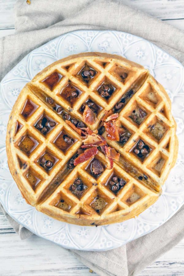 overhead images of a bacon chocolate chip waffle with syrup and extra chocolate chips and bacon sprinkled on top