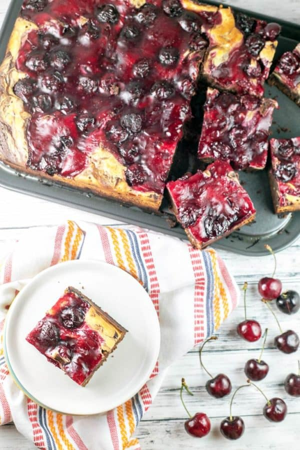 Cherry Cheesecake Brownies: made entirely from scratch with thick, fudgy brownies, a creamy layer of cheesecake batter, and homemade cherry pie filling on top. {Bunsen Burner Bakery}