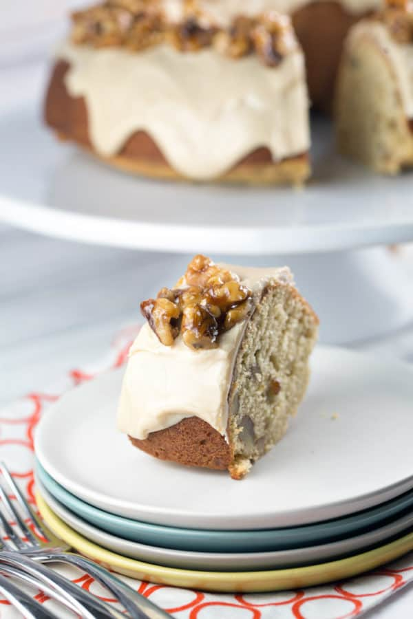 Maple Walnut Bundt Cake: vanilla bundt cake filled with maple and walnut, a thick layer of maple frosting, topped with homemade maple glazed walnut. It's the perfect fall cake! {Bunsen Burner Bakery}