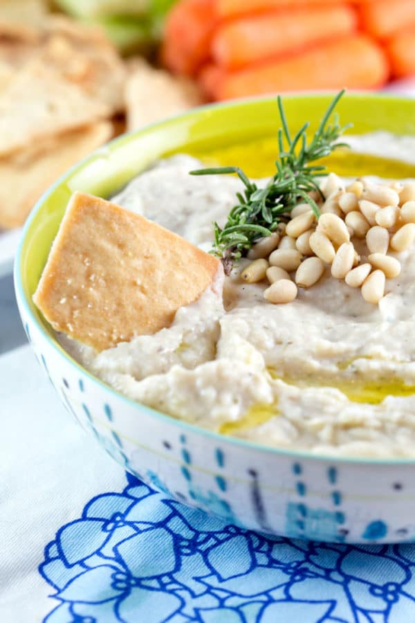 Roasted Garlic White Bean Dip: Who knew the perfect party dip could also be healthy? So delicious, you'll never guess it's gluten free and vegan! {Bunsen Burner Bakery}