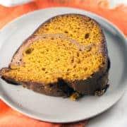 Cream Cheese Swirl Pumpkin Bundt Cake: Make pumpkin bread even better by turning it into a cinnamon cream cheese swirled, chocolate ganache covered, pumpkin bundt cake! Perfect for brunch or dessert, this sky-high bundt cake is just waiting for all your fall celebrations. #bunsenburnerbakery #bundtcake #pumpkincake #creamcheeseswirl