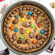 Leftover Candy Cookie Cake: You could eat your candy... or you can turn it into an outrageous soft and chewy candy cookie cake filled with all your favorite candy! #candy #Halloween #HalloweenCandy #cookiecake {Bunsen Burner Bakery}
