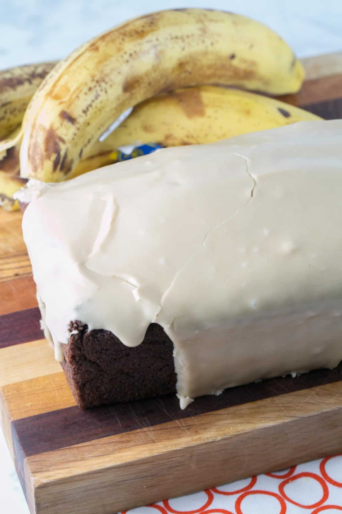 loaf of banana bread covered in a smooth maple glaze