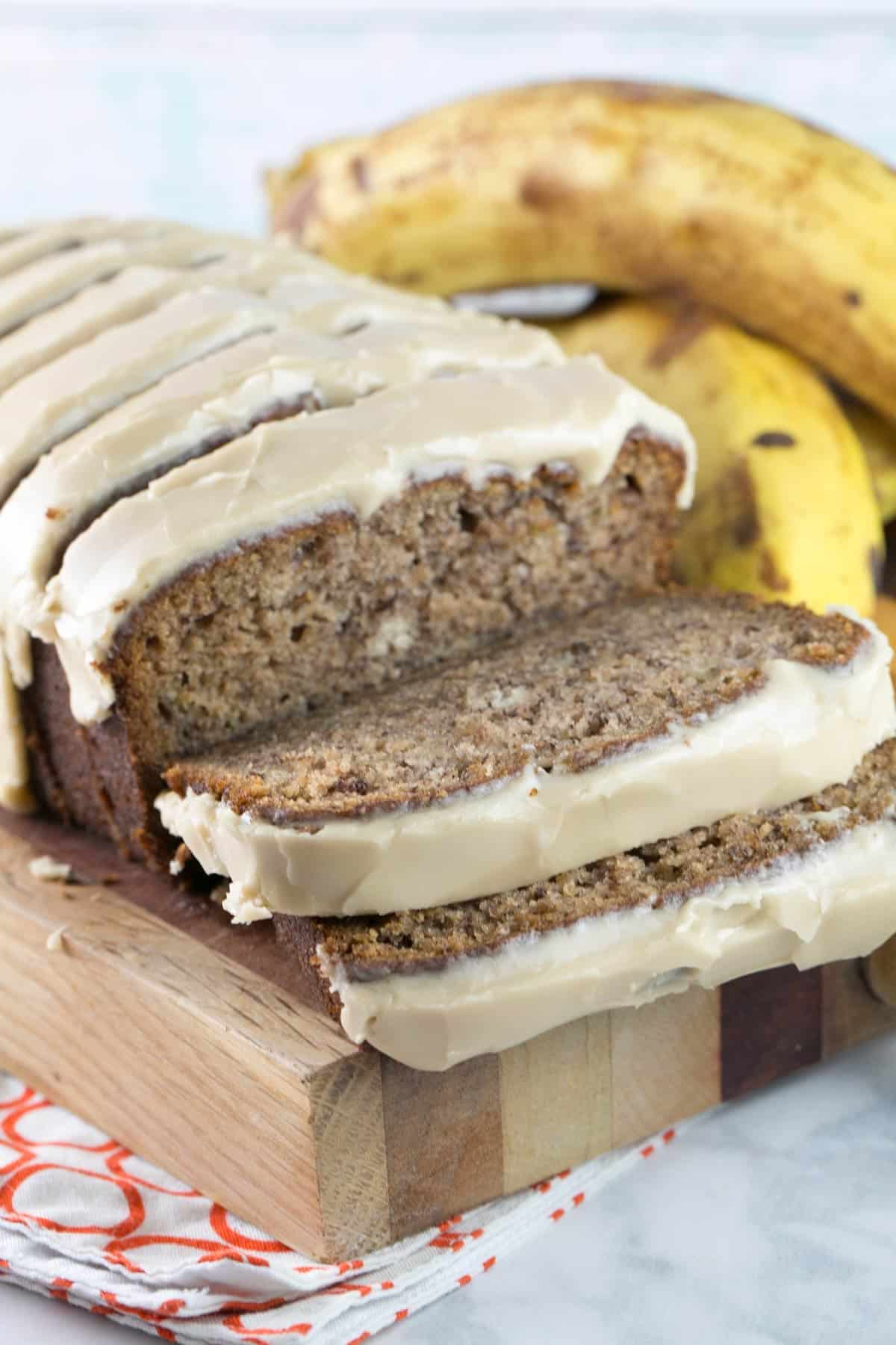 straight on photo of sliced banana bread with a maple glaze