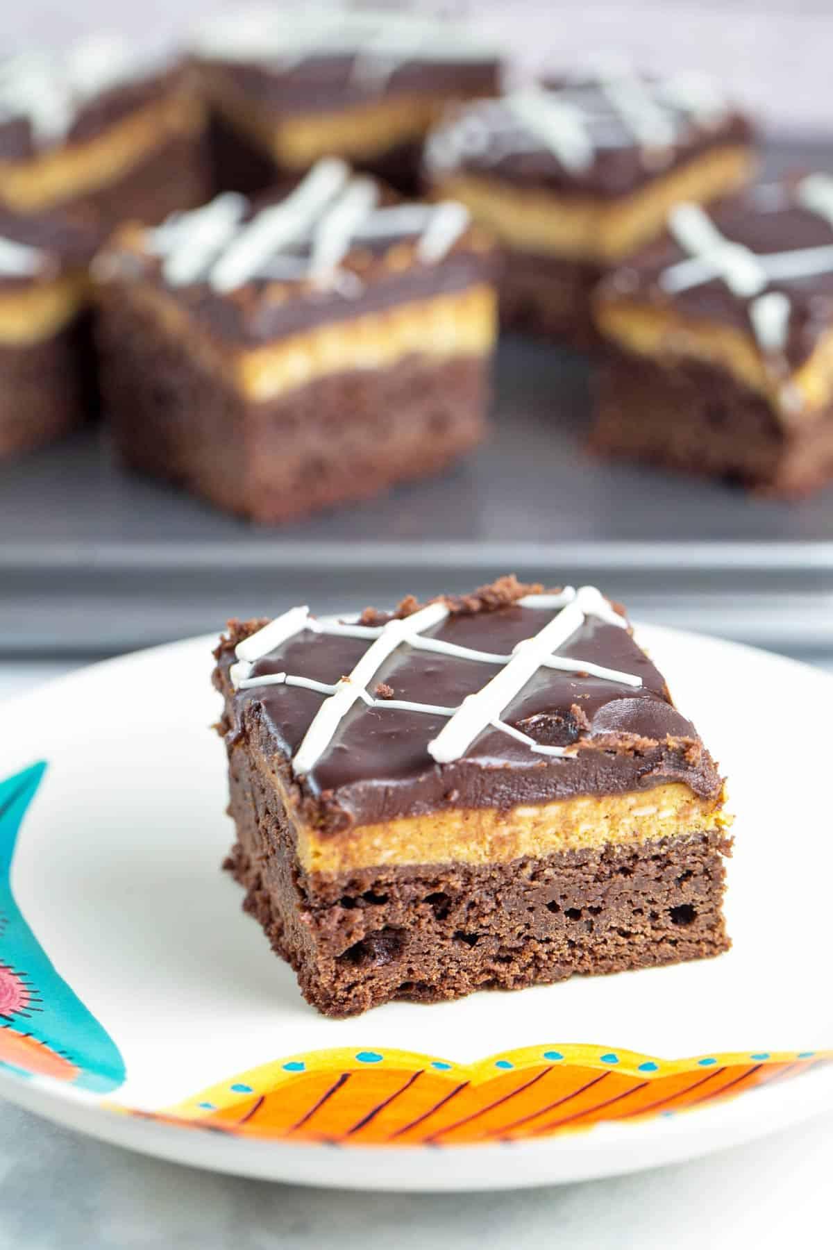 pumpkin cheesecake brownies on a white plate