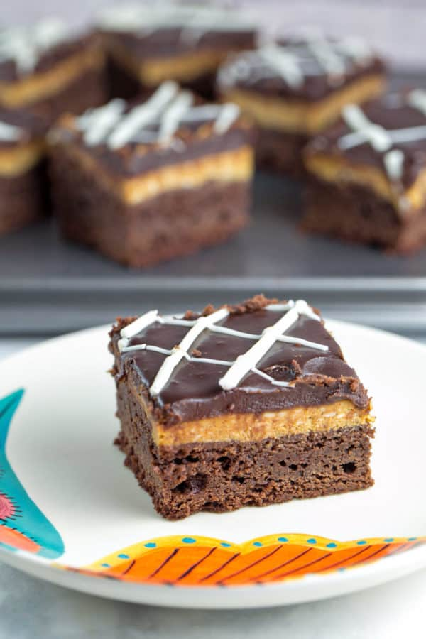 Pumpkin Cheesecake Brownies: Easy homemade brownies topped with smooth and creamy pumpkin cheesecake. The perfect fall dessert! {Bunsen Burner Bakery}