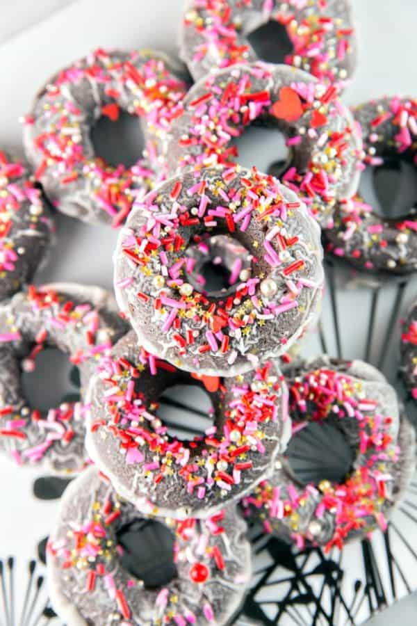 Baked Peppermint Mocha Donuts: chocolatey, cake, baked peppermint mocha donuts, dunked in a peppermint mocha glaze and covered with festive sprinkles. Breakfast? Dessert? Perfect for holiday entertaining, any time of day! {Bunsen Burner Bakery} #donuts #bakeddonuts #peppermintmocha #holiday