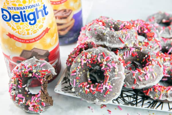 Baked Peppermint Mocha Donuts: chocolatey, cake, baked peppermint mocha donuts, dunked in a peppermint mocha glaze and covered with festive sprinkles. Breakfast? Dessert? Perfect for holiday entertaining, any time of day! {Bunsen Burner Bakery} #donuts #bakeddonuts #peppermintmocha #holiday [ad]