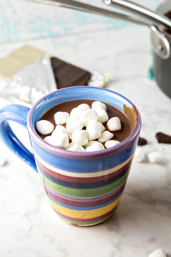 striped mug full of dark hot chocolate