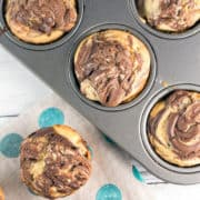 Nutella Swirl Cupcakes: rich, buttery cupcakes with decadent swirls of nutella baked right on top. These self-frosting cupcakes are ideal for travel: just toss in a bag and go! {Bunsen Burner Bakery} #cupcakes #nutella