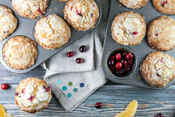 Cranberry Orange Streusel Muffins: tart cranberries and oranges pair perfectly with a sweet crumbly streusel topping in these giant, domed muffins. The best way to start off a cold, dreary winter morning! {Bunsen Burner Bakery} #muffins #streusel #cranberryorange