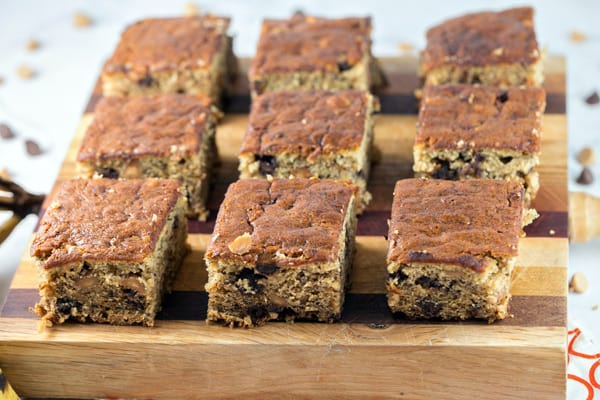 Peanut Butter Chocolate Chip Banana Bars: banana bread meets blondie meets sheet cake, these banana bars are full of chocolate and peanut butter chips. Easy to bake and perfect to share, in less time than banana bread. {Bunsen Burner Bakery}