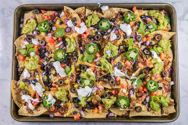 Sheet Pan Nachos: the ultimate loaded nachos are just 10 minutes and one sheet pan away. Easy entertaining - perfect for parties... or dinner! {Bunsen Burner Bakery} #nachos #appetizers #partyfood #superbowl