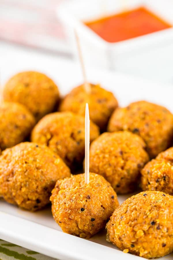 Spicy Buffalo Quinoa Bites: the perfect vegetarian and gluten-free appetizer for your football party or tailgate! Crispy quinoa surrounding a melted cheesy center, covered in spicy buffalo sauce. A hit with both meat eaters and vegetarians alike! {Bunsen Burner Bakery} #vegetarian #glutenfree #superbowlparty #appetizers