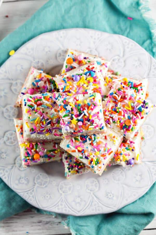 Sprinkle Sugar Cookie Bars: soft and sweet frosted cookie bars, perfect for any celebration! {Bunsen Burner Bakery} #cookies #cookiebars #sugarcookies #sprinkles