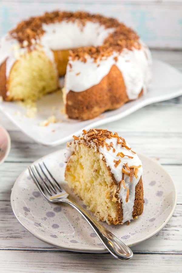 Coconut Bundt Cake: an exceptionally moist triple-coconut cake (coconut milk, coconut extract, and shredded coconut) topped with a coconut glaze and toasted coconut. Outrageously delicious! {Bunsen Burner Bakery} #coconutcake #bundtcake #coconut