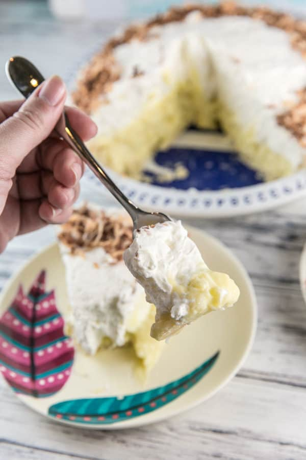 Coconut Cream Pie: packed full of triple coconut flavor and a sky-high pile of whipped cream. Perfect to celebrate spring and Easter! {Bunsen Burner Bakery} #pie #coconutcreampie #easter #coconut