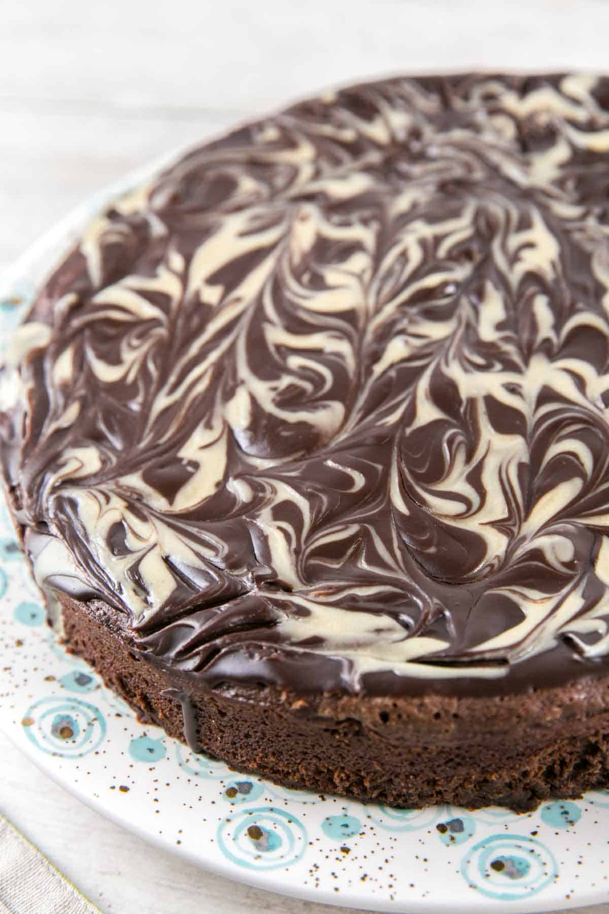 Flourless Chocolate Tahini Cake: Gluten free, Passover friendly, delicious all the time. A rich, decadent flourless chocolate cake with swirls of tahini make an easy, elegant cake. {Bunsen Burner Bakery} #glutenfree #passover #tahini #cake