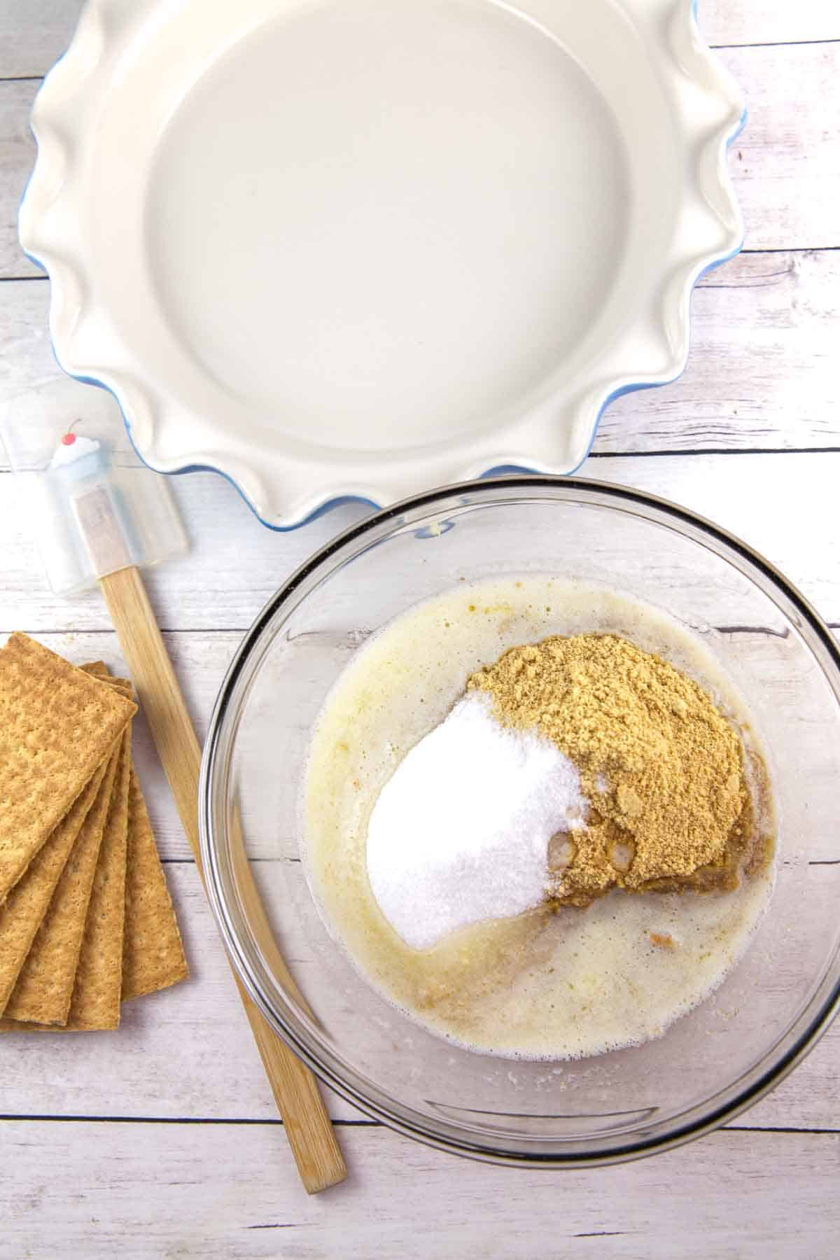 Perfect Graham Cracker Pie Crust: Learn how to make the perfect Graham cracker crust from scratch with these simple tips to keep it from falling apart! {Bunsen Burner Bakery} #pie #piecrust #grahamcrackercrust