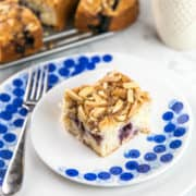 Almond Blueberry Breakfast Cake: a light buttermilk blueberry cake with an almond streusel toping, perfect for breakfast or as as a not-so-sweet dessert. {Bunsen Burner Bakery} #breakfastcake #coffeecake #blueberrycake