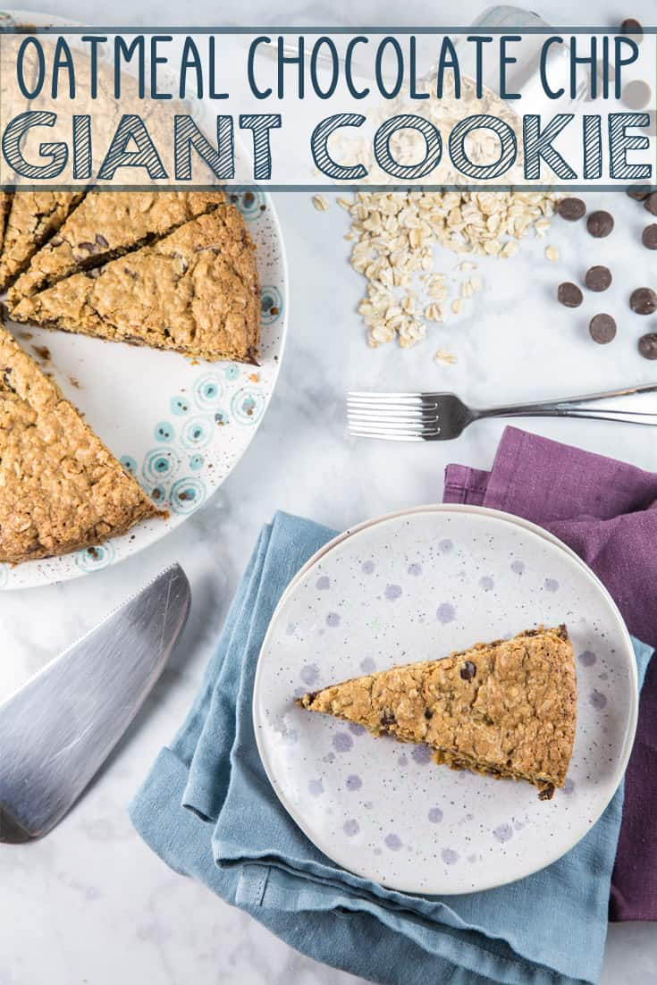 Giant Oatmeal Chocolate Chip Cookie: crispy and firm on the outside and soft and chewy in the center, this giant cookie/cookie cake is the perfect crowd pleasing dessert to share! {Bunsen Burner Bakery} #cookie #oatmealchocolatechip #giantcookie #cookiecake