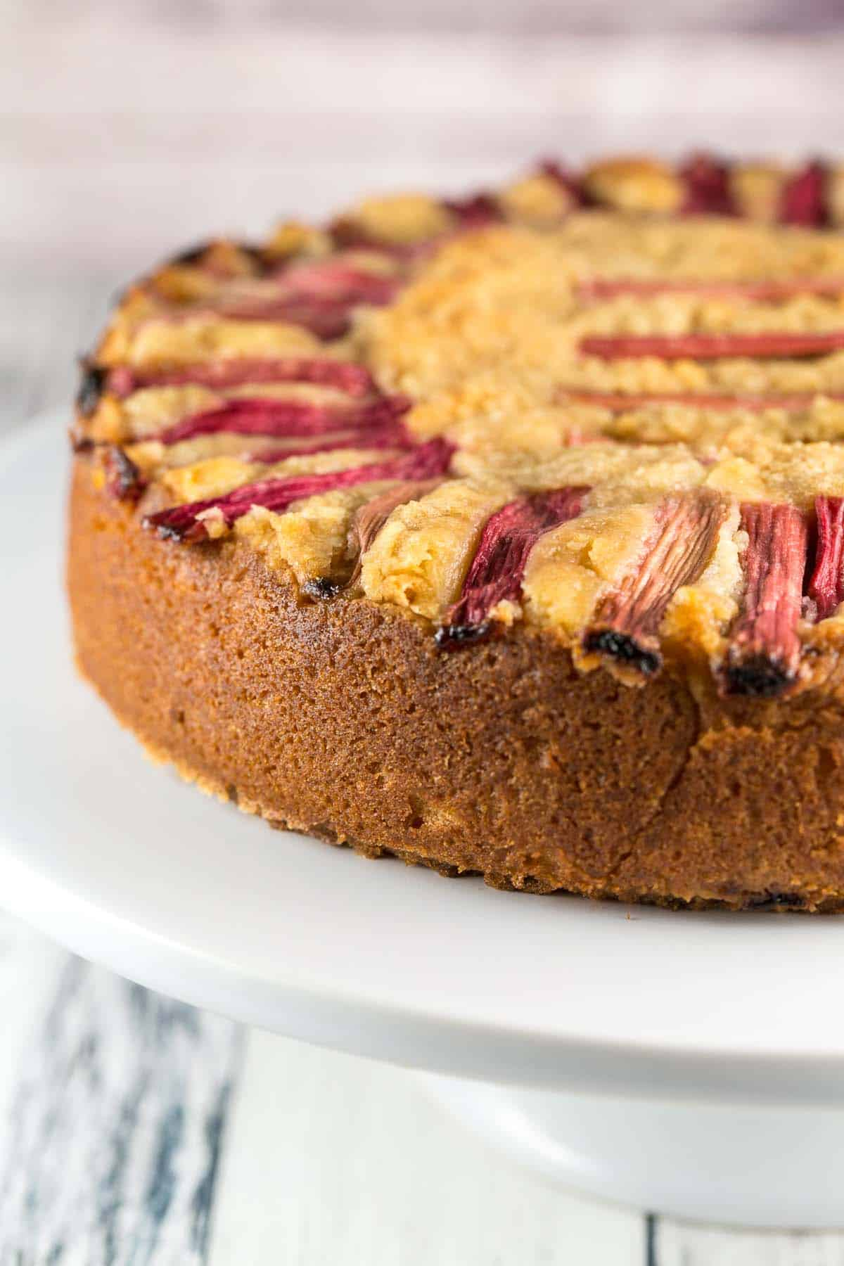 Almond Rhubarb Cake: a light and fluffy almond cake filled with sliced rhubarb. Top with ice cream and rhubarb syrup for an extra treat! {Bunsen Burner Bakery} [ad] #rhubarb #almond #cake #coffeecake