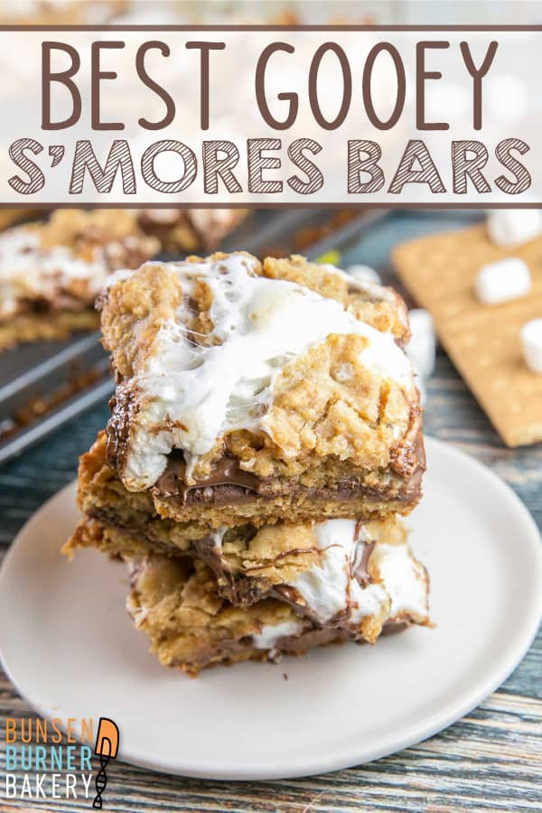 Gooey S'mores Bars: Make your s'mores easy to share and indoor appropriate by baking them in bar form with a layer of graham cracker cookie crust, melted chocolate, and sticky marshmallows. #smores #smoresbars #dessertbars #cookiebars