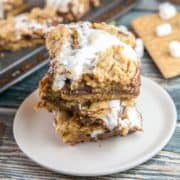 Gooey S'mores Bars: Make your s'mores easy to share at summer picnics by baking them in bar form with a layer of graham cracker cookie crust, melted chocolate, and sticky marshmallows. #smores #smoresbars #dessertbars #cookiebars