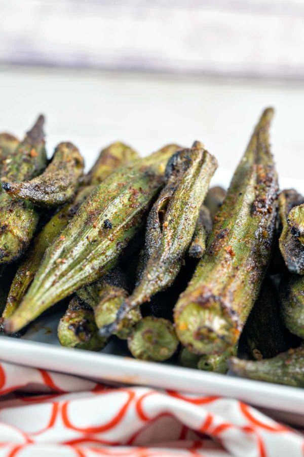 lightly charred okra pods covered in garlic powder, chili powder, cumin, and smoked paprika