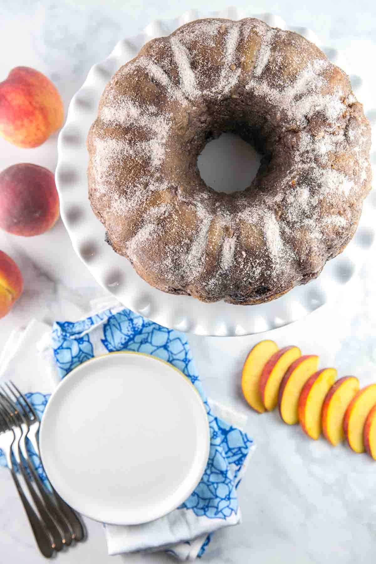 Cinnamon Sugar Peach Bundt Cake: An easy mix-by-hand dairy free peach bundt cake with a crunchy cinnamon sugar shell. {Bunsen Burner Bakery} #cake #bundtcake #peachcake #cinnamonsugar