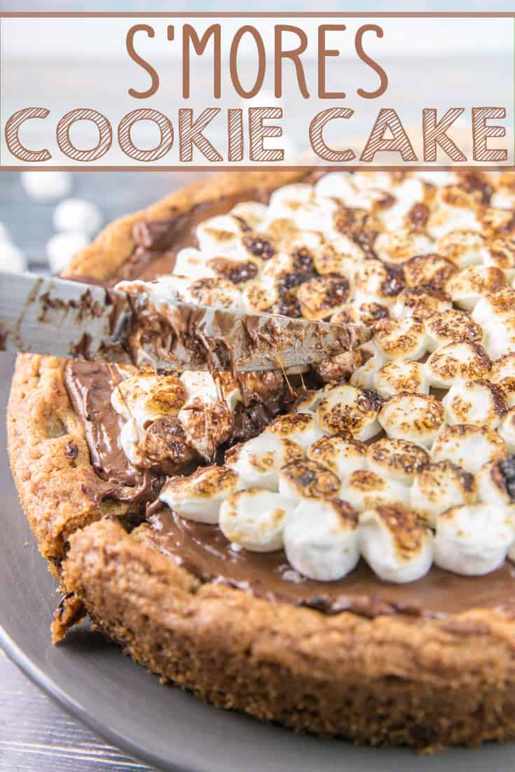 S'mores Cookie Cake: a giant graham cracker chocolate chip cookie cake, covered with a layer of melted milk chocolate and toasted s'mores. A perfect nostalgic childhood treat! {Bunsen Burner Bakery} #smores #cookiecake #giantcookie #smorescookiecake