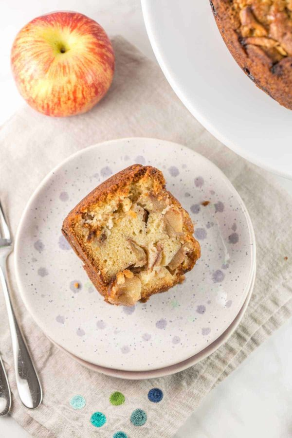 a slice of homemade apple cake filled with fresh apples and cinnamon