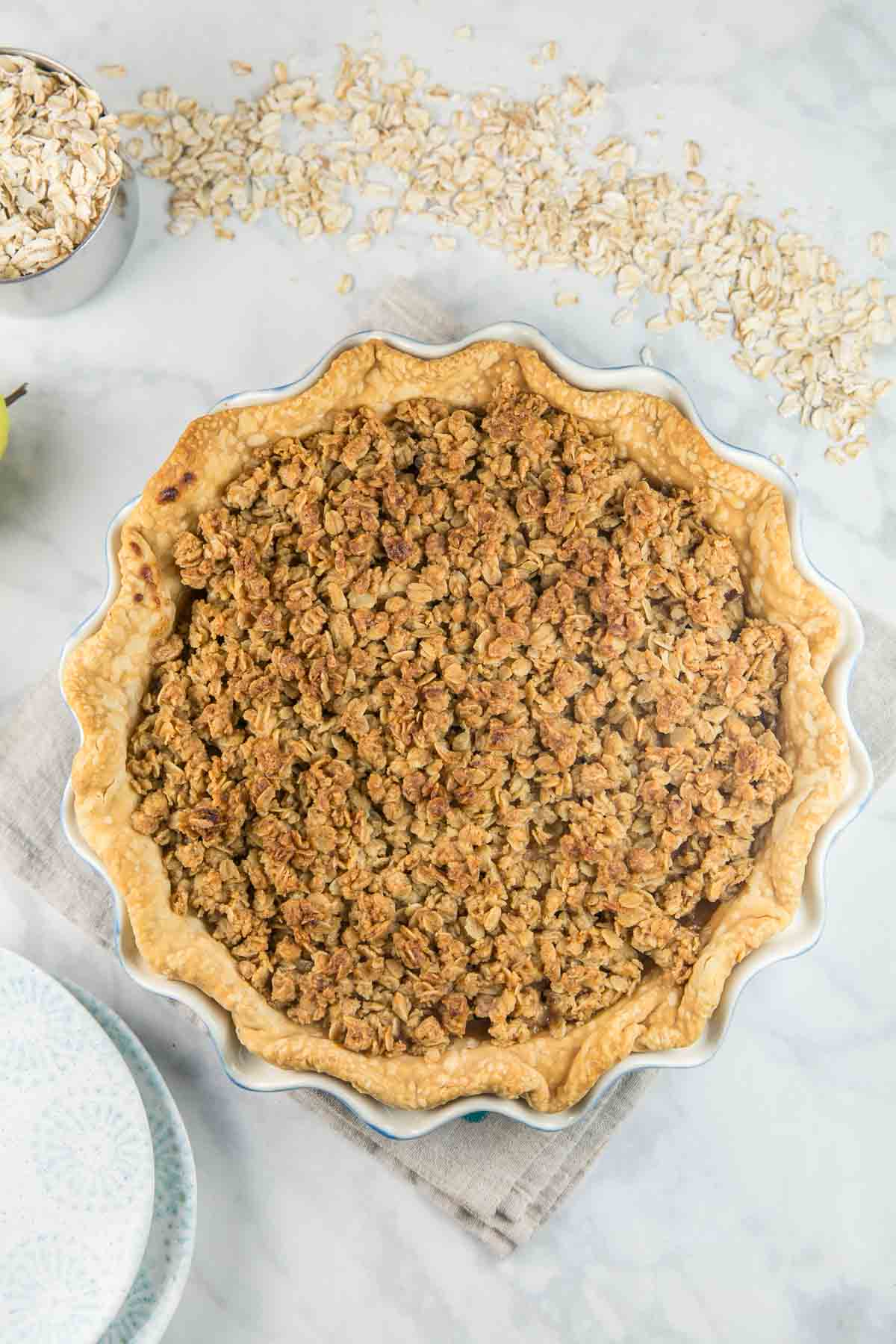 overhead view of a baked caramel pear pie covered in a golden oatmeal cookie crumble