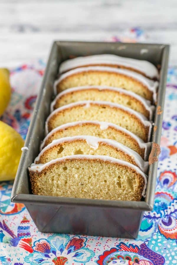 slices of lemon pound cake covered in lemon glaze sliced and arrange in a loaf pan