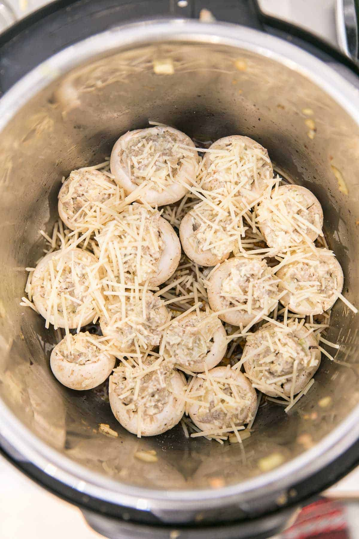 Instant Pot Stuffed Mushrooms: a classic sausage stuffed mushroom recipe, updated for your pressure cooker. Leave the oven free for dessert and make stuffed mushrooms right in the Instant Pot with fewer dishes, less time, and more flavor. #bunsenburmerbakery #partyfood #superbowlparty #appetizers #ad