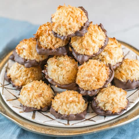 Chocolate Dipped Coconut Macaroons: It's just not spring without a batch of these homemade chocolate dipped coconut macaroons! These sweet treats are so easy to make, there's no reason to buy them from a can. #bunsenburnerbakery #macaroons #coconutmacaroons #glutenfree #passover