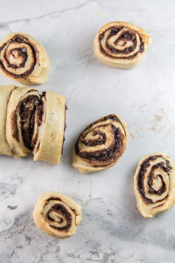a sliced roll of babka dough with chocolate filling for babka muffins