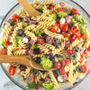 Classic Italian Pasta Salad: full of fresh vegetables, cheese, and salami, this colorful pasta salad is the perfect summer side. An extremely easy crowd pleaser that is even better when made ahead of time! #bunsenburnerbakery #pastasalad #summerside #pasta #picnic