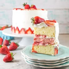 Strawberry Layer Cake with Whipped Cream Frosting: Perfect for all your summer celebrations, this strawberry layer cake is made entirely with real strawberries and filled with thick layers of homemade strawberry puree. #bunsenburnerbakery #cake #layercake #strawberrycake #strawberries