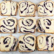 Blueberry Babka with Almond Streusel: homemade blueberry jam swirled in a rich babka dough, topped with crunchy almond streusel.  With step-by-step photos and instructions, this blueberry babka recipe is easy enough for even new bakers! #bunsenburnerbakery #babka #bread #blueberrybread