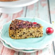 Chocolate Chip Cherry Upside Down Cake: an easy one bowl sour cream coffee cake recipe turned into a chocolate cherry upside down cake make with fresh cherries.  The perfect make ahead breakfast or snack cake -- keep one in your freezer to pull out for unexpected guests! #bunsenburnerbakery #upsidedowncake #cherrycake #cherrychocolatecake