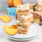 Peach Pie Bars: Easy peach pie bars with an oatmeal cinnamon crumble topping.  Easy to make and full of delicious fresh peaches, these are the perfect pie bars to share at summer picnics and parties. #bunsenburnerbakery #pie #peaches #piebars #peachpie #dessertbars
