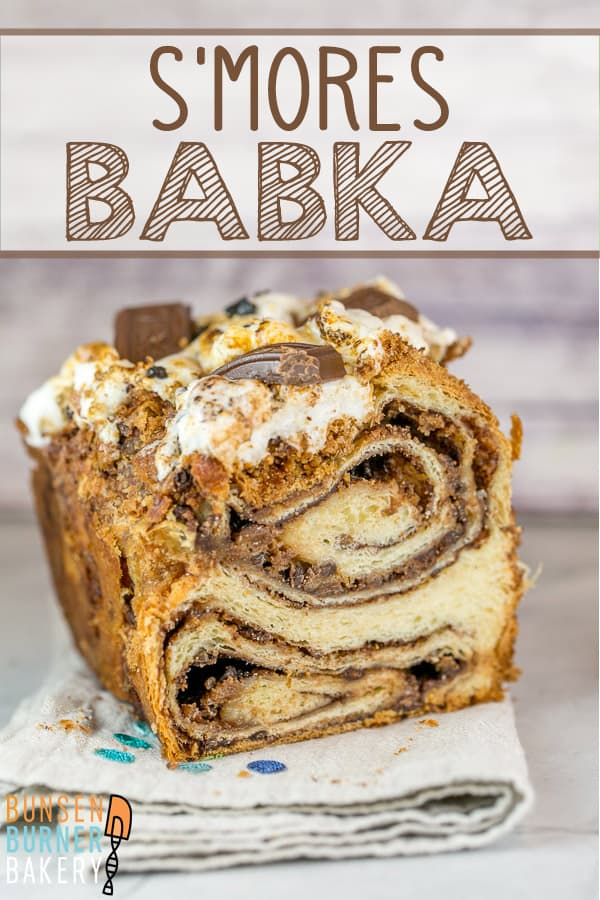 S'mores Babka: Think chocolate babka is the best babka?  Think again -- with this s'mores babka!  Add graham crackers and gooey toasted marshmallows for an extra special treat! #bunsenburnerbakery #smores #babka #yeastbread #smoresdesserts