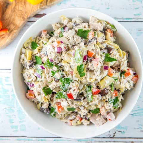 Mediterranean Tuna Salad: This easy make-ahead recipe is full of flavor and anything but boring! Full of marinated artichokes, bell peppers, Greek olives, parsley, and lemon juices, it's healthy, delicious, and the perfect lunch or dinner. #bunsenburnerbakery #tunasalad #tuna #glutenfree