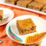 Chocolate Chip Pumpkin Pie Bars: These made from scratch creamy pumpkin pie bars with a graham cracker crust are perfect for holiday parties and potlucks.   An easy freezer friendly recipe so you can make them ahead of time, too! #bunsenburnerbakery #pumpkinpie #piebars #pumpkin #thanksgiving